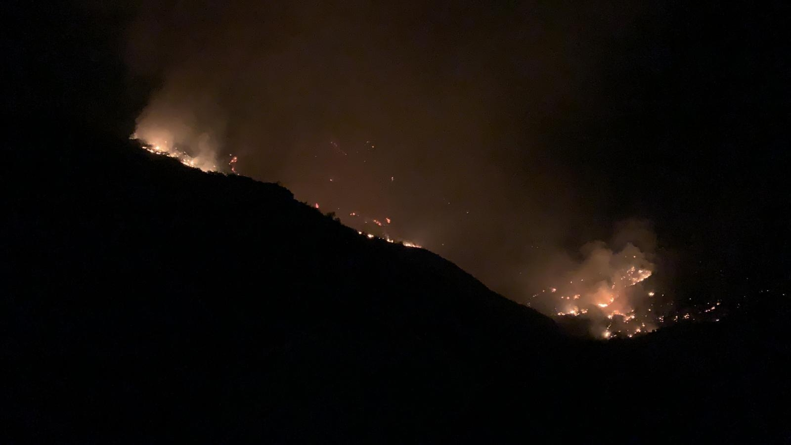 <p>In this photo issued by Cabildo de Gran Canaria, flames from a forest fire burn in Tejada, on the Spanish Gran Canaria island on Tuesday Aug. 20, 2019. The wind dropped overnight in the Canary Islands, allowing firefighters to make progress Tuesday against Spain&#8217;s biggest wildfire so far this year. (Cabildo de Gran Canaria Via AP)</p>