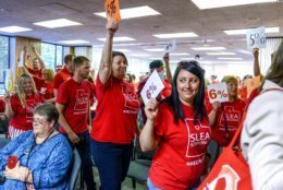 In this June 4, 2019 photo, teachers walk out of the public comment period at the Salt Lake City School District meeting regarding salary negotiations, in Salt Lake City. Across the country, teachers and school districts alike are grappling with the latest political and economic realities of educator pay.   (Leah Hogsten/The Salt Lake Tribune via AP)