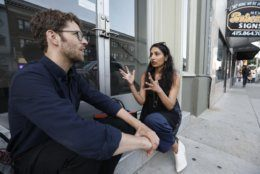 In this Aug. 15, 2019, photo Veena Dubal, a professor at the University of California Hastings College of the Law, talks with user experience researcher Danny Spitzberg in San Francisco. Dubal has interviewed dozens of tech workers involved in organizing and activism as part of her research on social change. In the past few years, tech employees have increasingly attempted to remake their industry from the inside out. (AP Photo/Samantha Maldonado)