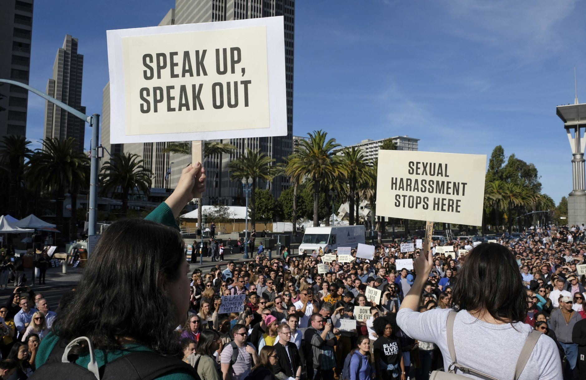 FILE - In this Nov. 1, 2018, file photo, Google employees hold up signs during a walkout rally at Harry Bridges Plaza in San Francisco to protest against what they said is the tech company's mishandling of sexual misconduct allegations against executives. Employees at Google, Amazon, Microsoft and elsewhere are increasingly speaking out about military warfare, immigration and the environment, and questioning the effects of their work. Experts say it's an unprecedented trend of activism in Big Tech. (AP Photo/Eric Risberg, File)