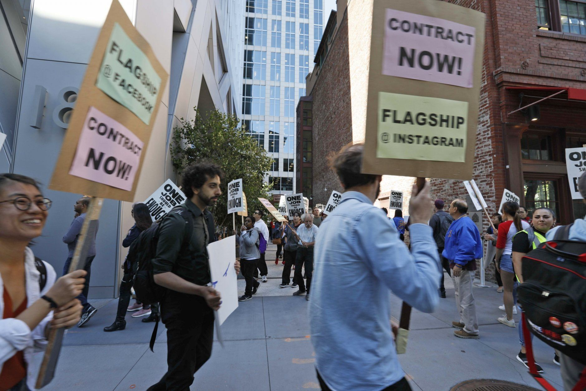 In this photo taken July 16, 2019, tech workers march to support Facebook's cafeteria workers, who were rallying for a new contract with their company Flagship in San Francisco. Tech workers are speaking out on issues of immigration, the environment, sexual misconduct and military warfare like never before. Google, Amazon and Microsoft employees protest against how their work is used by the government. Through petitions and collective actions, others push for better internal policies, greener practices and better work conditions for contractors. (AP Photo/Samantha Maldonado)