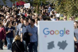 FILE - In this Nov. 1, 2018, file photo, workers leave Google's Mountain View, Calif., main quad after some Google employees walked off the job in a protest against what they said is the tech company's mishandling of sexual misconduct allegations against executives. Employees at Google, Amazon, Microsoft and elsewhere are increasingly speaking out about military warfare, immigration and the environment, and questioning the effects of their work. Experts say it's an unprecedented trend of activism in Big Tech. (AP Photo/Noah Berger, File)