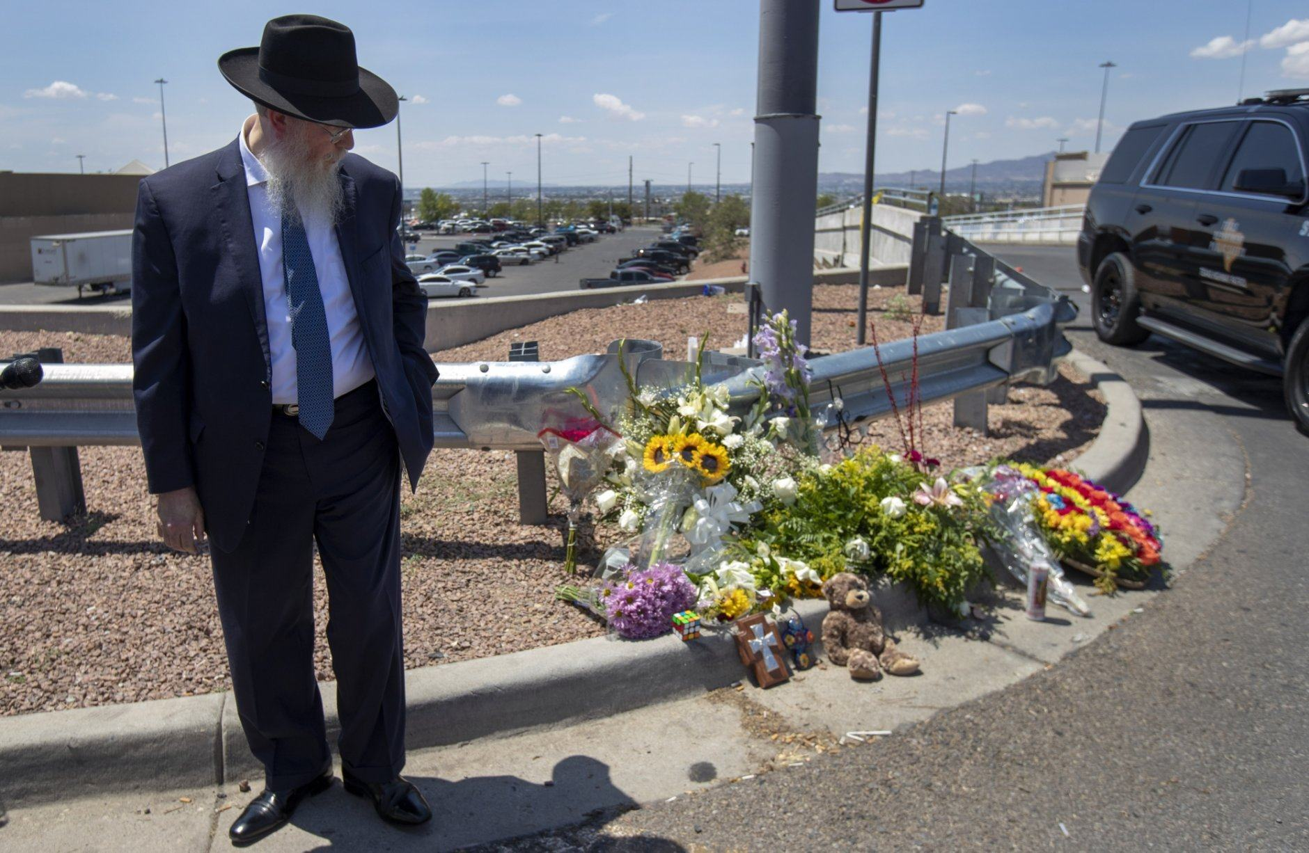Rabbi Yisrael Greenberg looks at the makeshift memorial while paying tribute to the victims of the Saturday mass shooting at a shopping complex in El Paso, Texas, Sunday, August 4, 2019. (AP Photo/Andres Leighton)
