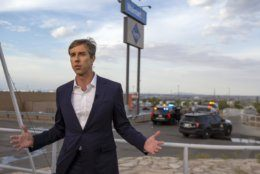 Presidential candidate and former congressman Beto O'Rourke speaks with the media outside the Walmart store in the aftermath of a mass shooting in El Paso, Texas, Sunday, Aug. 4, 2019. (AP Photo/Andres Leighton)