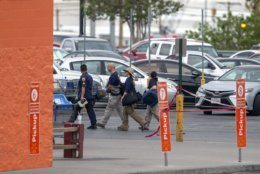 FBI agents arrive to the Walmart store in the aftermath of a mass shooting in El Paso, Texas, Sunday, Aug. 4, 2019. A gunman opened fire Saturday killing over a dozen. (AP Photo/Andres Leighton)