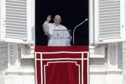 Pope Francis waves to faithful during the Angelus noon prayer in St. Peter's Square at the Vatican, Sunday, Aug. 25, 2019. The Pontiff says the Amazon forest is vital for our Earth and is urging prayers that fires there are quickly controlled. Francis added his voice Sunday to the chorus of international concern that the blazes in Brazil will have grave repercussions on the world's environmental health. (AP Photo/Gregorio Borgia)