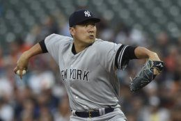 New York Yankees pitcher Masahiro Tanaka throws to the Baltimore Orioles in the first inning of a baseball game, Monday, Aug. 5, 2019, in Baltimore. (AP Photo/Gail Burton)