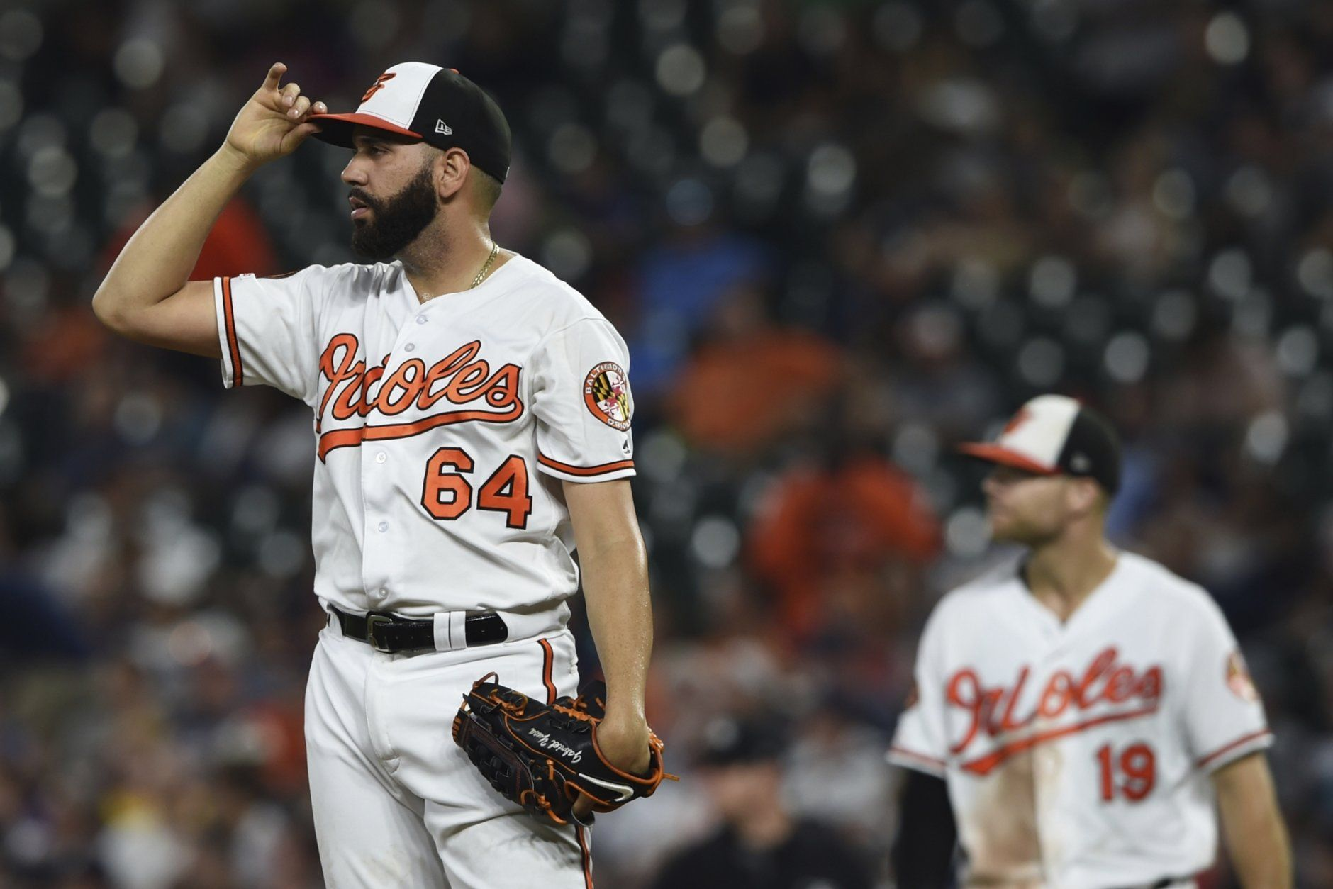 Baltimore Orioles pitcher Gabriel Ynoa looks to the outfield after giving up three runs to the New York Yankees in the third inning of a baseball game, Monday, Aug. 5, 2019, in Baltimore. (AP Photo/Gail Burton)