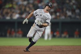 New York Yankees' Brett Gardner runs to third on a single by Mike Tauchman against the Baltimore Orioles in the fifth inning of a baseball game, Monday, Aug. 5, 2019, in Baltimore. (AP Photo/Gail Burton)
