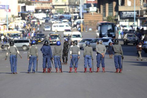 Zimbabwe's police beat anti-government protesters in capital