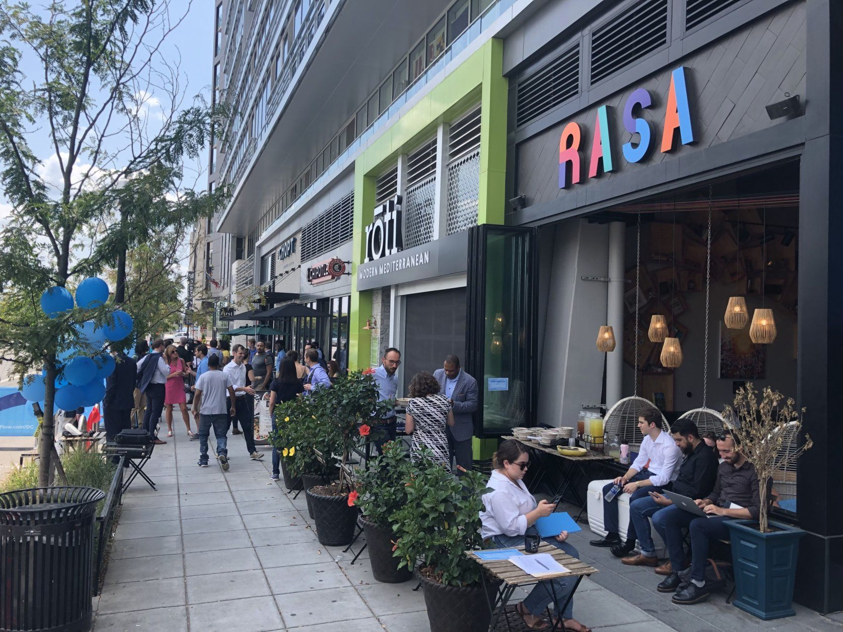 Thursday's announcement and ribbon cutting was along a busy restaurant and fast casual food area near Nationals Park on First Street, just south of M Street, in Southeast. (WTOP/Kristi King)
