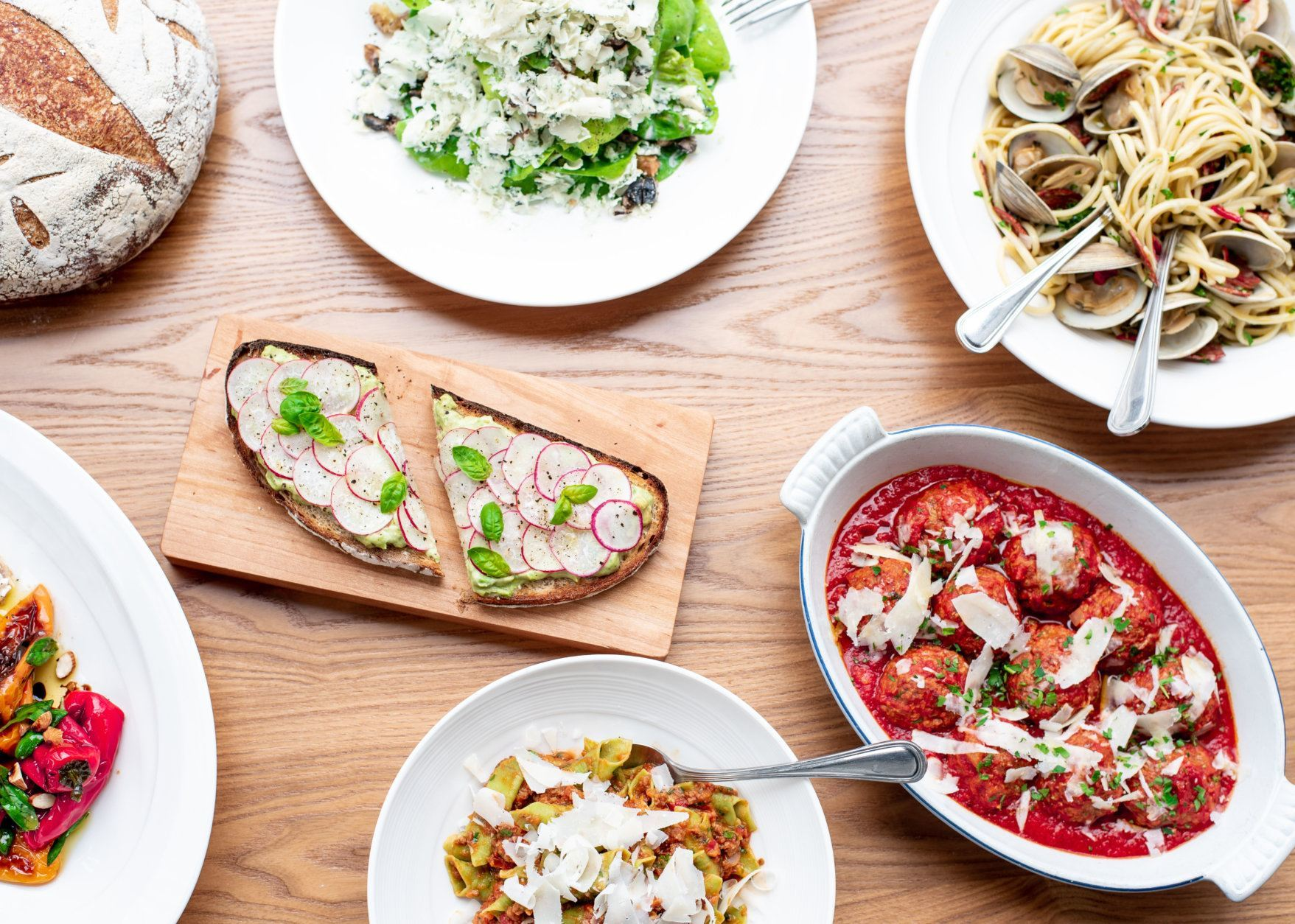 A spread of food featured at Thompson Italian