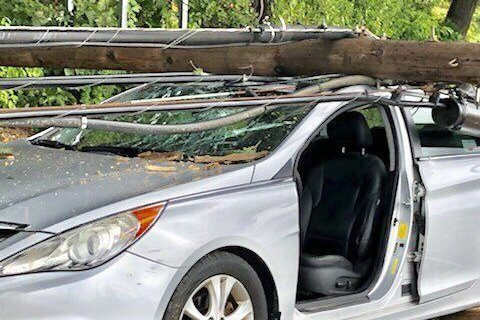 Utility pole with live wires crashes into car in Montgomery Co.