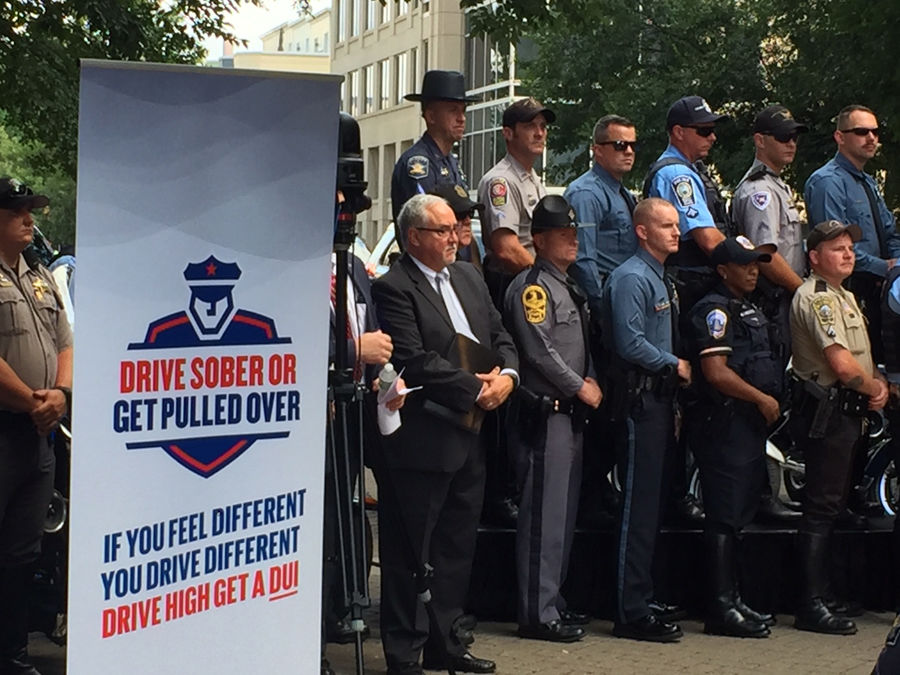 police at news conference announcing crackdown