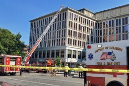 D.C. firefighters battled a blaze Wednesday morning at a large office building above the Van Ness Metro in Northwest D.C.