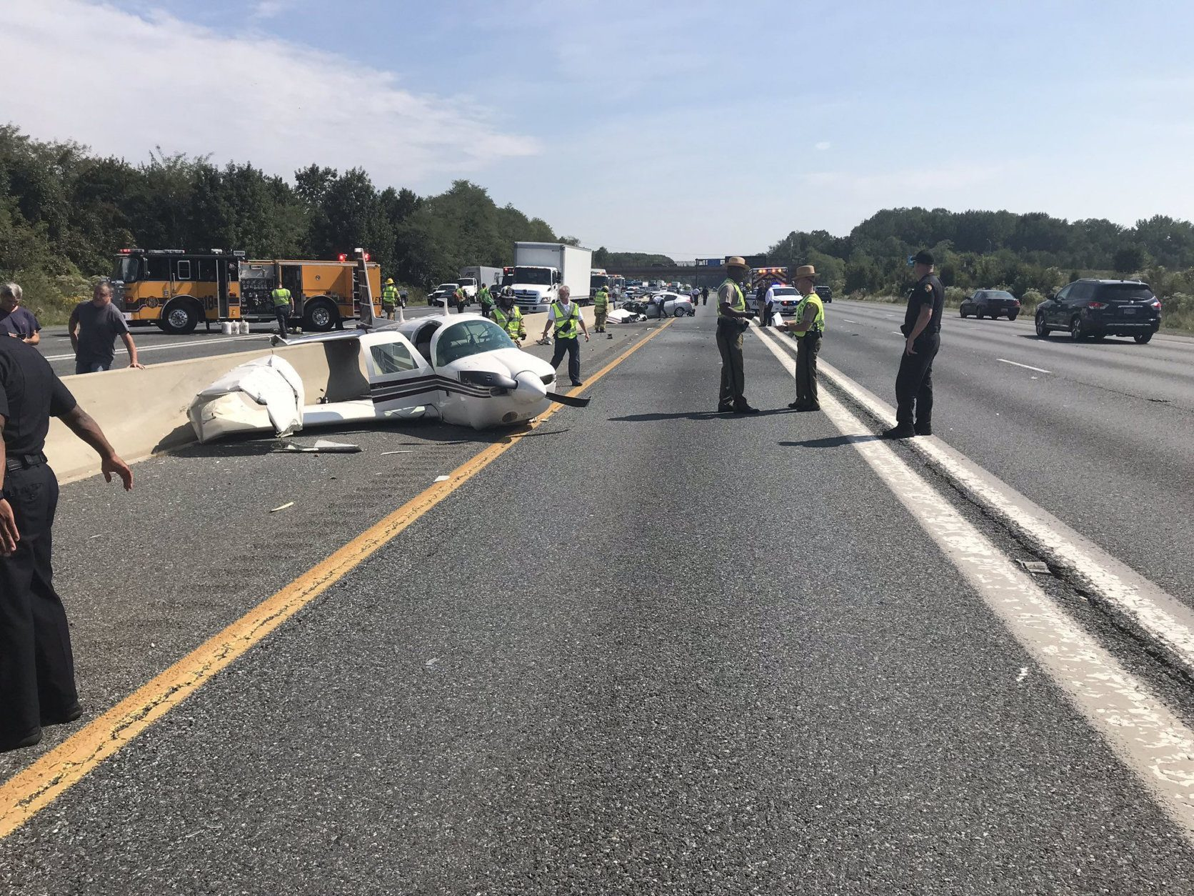 Authorities say it appears the plane was trying to land at a nearby airport when it crashed into a highway car.