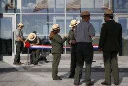 National Park Service rangers prepare a ribbon for a ribbon-cutting ceremony with first lady Melania Trump to re-open the Washington Monument, Thursday, Sept. 19, 2019, in Washington. The monument has been closed to the public for renovations since August 2016. (AP Photo/Patrick Semansky)