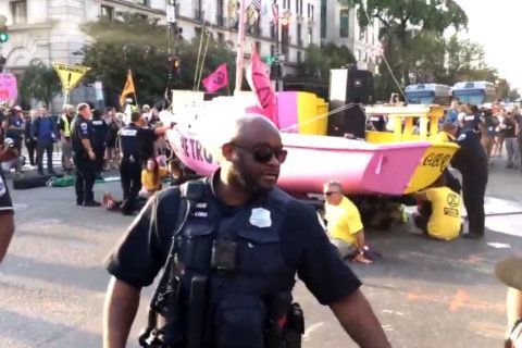 Arrests made as climate protesters disrupt DC traffic