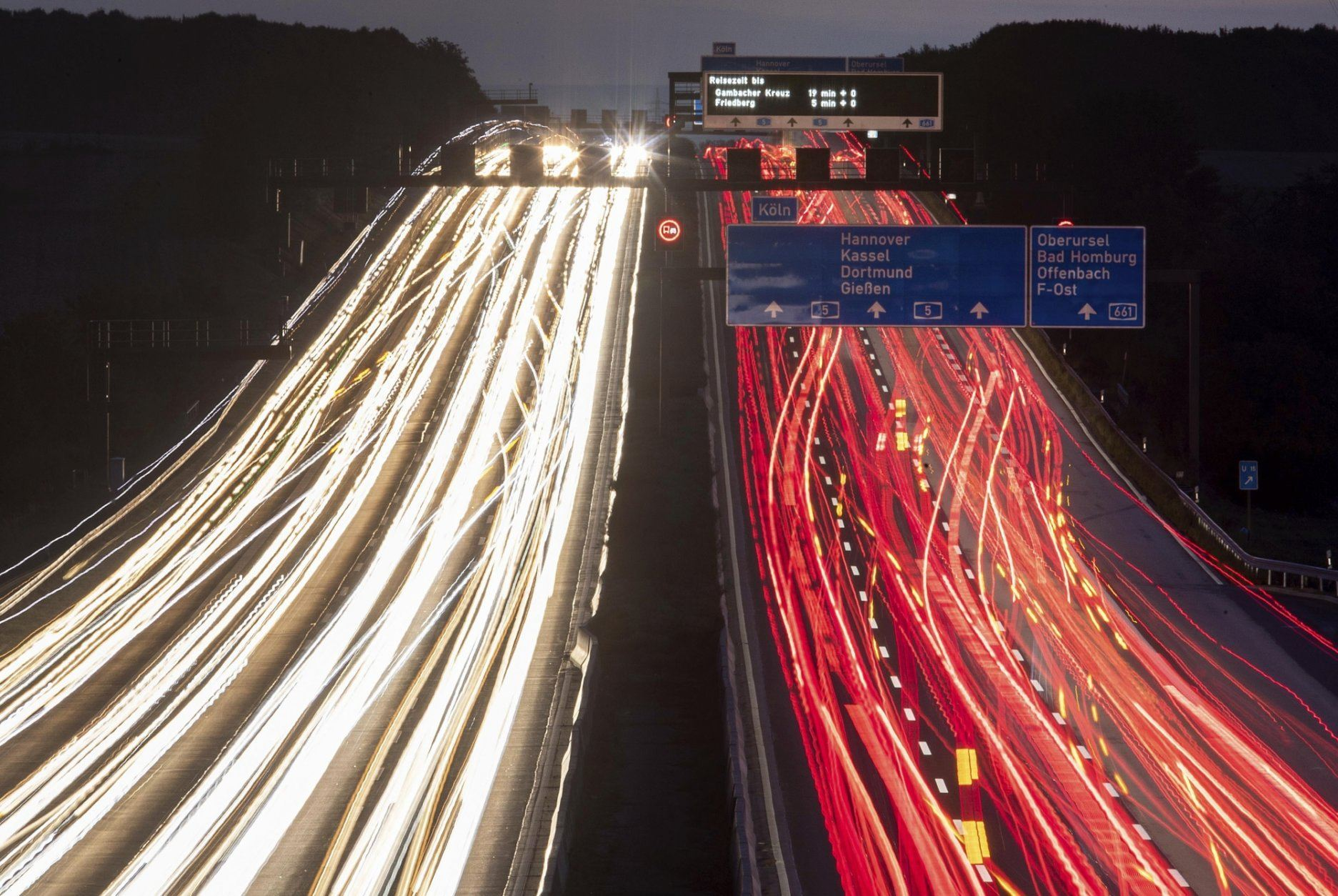 In this long exposure photo cars drive on a highway in Frankfurt, Germany, early Thursday, Sept. 19, 2019. (AP Photo/Michael Probst)