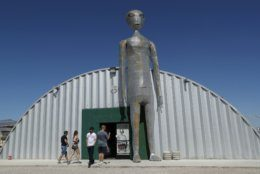 "People enter and exit the Alien Research Center in Hiko, Nev. No one knows what to expect, but lots of people are preparing for ""Storm Area 51"" on Wednesday, Sept. 18, 2019, in the Nevada desert. Neighbors, elected officials and experts say the craze sparked by an internet joke inviting people to """"see them aliens"" might become a cultural marker, a dud or something in-between. (AP Photo/John Locher)"