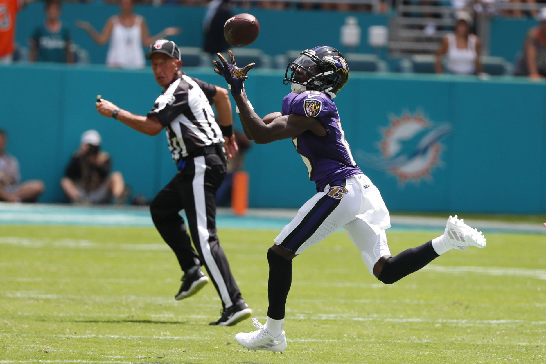 "<p><b><i>Ravens 59</i></b><br /> <b><i>Dolphins 10</i></b></p> <p>Marquise Brown's first two NFL catches were touchdowns totaling 130 yards, making him the first player in NFL history to score multiple 40-yard touchdowns in his career debut. Veterans Mark Ingram and Earl Thomas also had great debuts for Baltimore, and Lamar Jackson rushed for only six yards but delivered on <a href=""https://www.baltimoreravens.com/news/lamar-jackson-can-t-wait-to-put-on-a-show-with-new-offense"">his promise to put on a show</a>, notching a perfect passer rating and matching a franchise record with five TDs in his hometown. Either this really is <a href=""https://wtop.com/nfl/2019/09/2019-afc-north-preview/"">a revolutionary offense</a>, or <a href=""https://profootballtalk.nbcsports.com/2019/09/08/early-mutiny-in-miami/"">Miami is right to mutiny</a>.</p>"