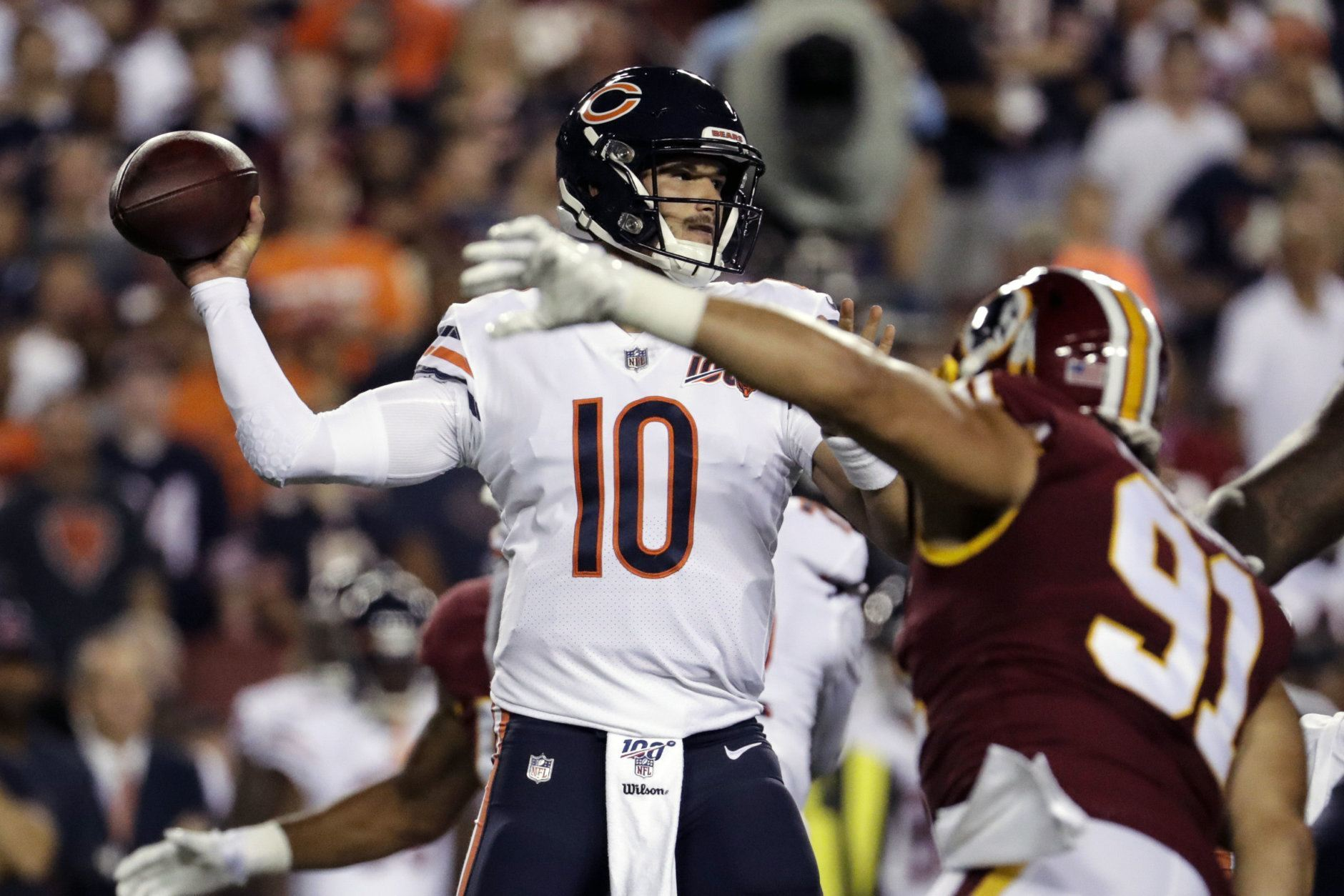 Chicago Bears quarterback Mitchell Trubisky (10) looks to pass under pressure from Washington Redskins outside linebacker Ryan Kerrigan (91) during the first half of an NFL football game Monday, Sept. 23, 2019, in Landover, Md. (AP Photo/Julio Cortez)
