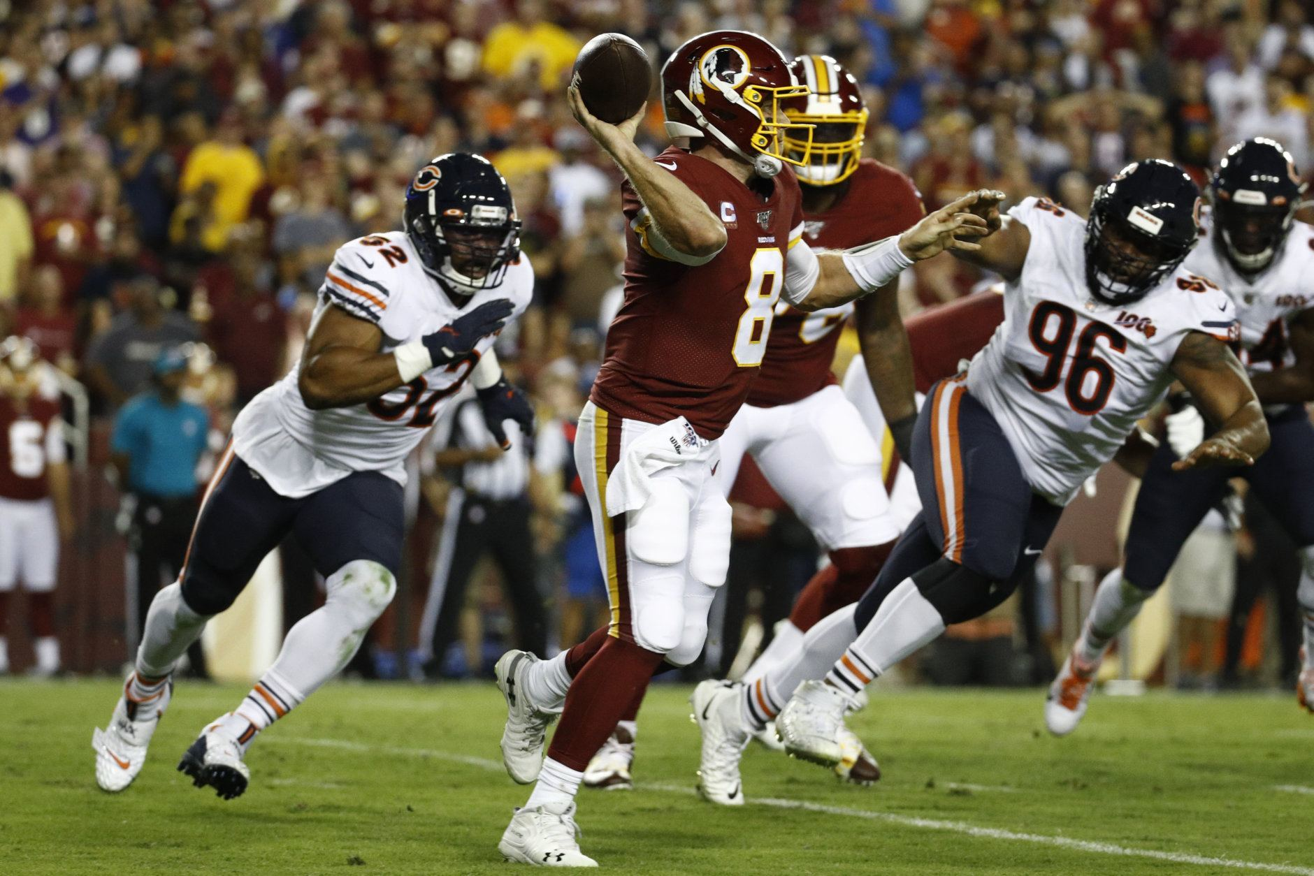 Washington Redskins quarterback Case Keenum (8) throws under pressure from Chicago Bears linebacker Khalil Mack (52) and tackle Akiem Hicks (96) during the first half of an NFL football game Monday, Sept. 23, 2019, in Landover, Md. (AP Photo/Patrick Semansky)