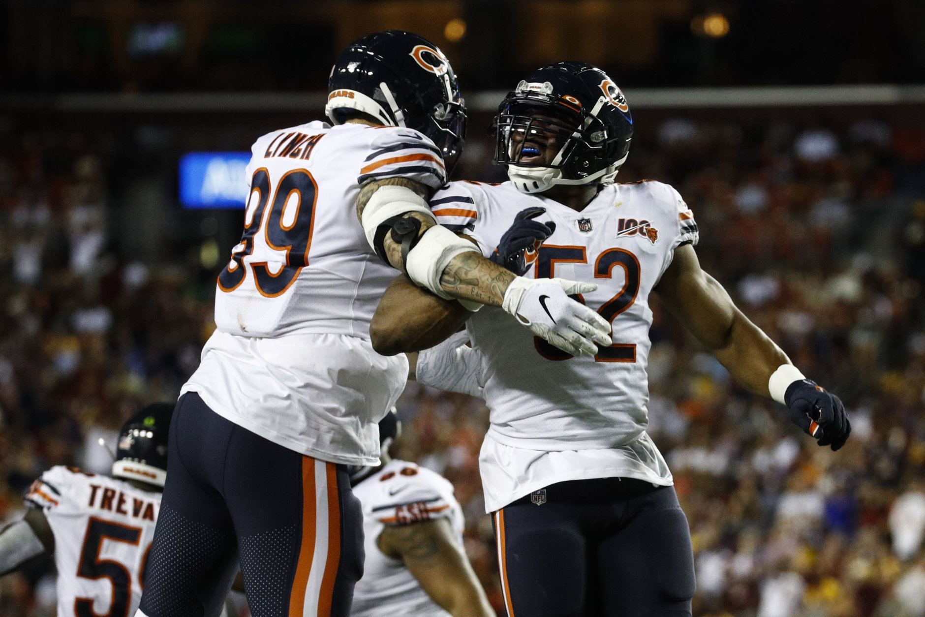Chicago Bears linebackers Aaron Lynch (99) and Khalil Mack (52) celebrate Mack's hit to cause a fumble by the Washington Redskins during the first half of an NFL football game Monday, Sept. 23, 2019, in Landover, Md. (AP Photo/Patrick Semansky)