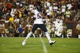 Chicago Bears outside linebacker Khalil Mack (52) celebrates his hit to cause a fumble during the first half of an NFL football game against the Washington Redskins, Monday, Sept. 23, 2019, in Landover, Md. (AP Photo/Patrick Semansky)