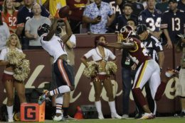 Chicago Bears wide receiver Taylor Gabriel (18) catches a pass for a touchdown in front of Washington Redskins cornerback Josh Norman (24) during the first half of an NFL football game Monday, Sept. 23, 2019, in Landover, Md. (AP Photo/Julio Cortez)