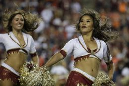The Washington Redskins cheerleaders perform during the first half of an NFL football game between the Washington Redskins and the Chicago Bears, Monday, Sept. 23, 2019, in Landover, Md. (AP Photo/Julio Cortez)