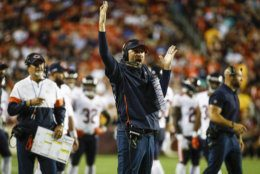 Chicago Bears head coach Matt Nagy, center, celebrates a touchdown by wide receiver Taylor Gabriel (18) after an official's review during the first half of an NFL football game against the Washington Redskins, Monday, Sept. 23, 2019, in Landover, Md. (AP Photo/Patrick Semansky)