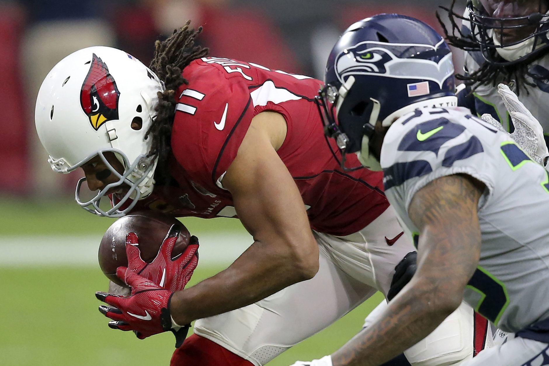 <p><b><i>Seahawks 27</i></b><br /> <b><i>Cardinals 10</i></b></p> <p>Ladies and gentlemen, give it up for the NFL&#8217;s second-leading receiver, Larry Fitzgerald — the only thing that makes being an Arizona Cardinals fan feel not-so-bad.</p>