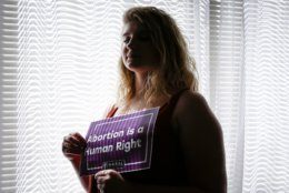 ADVANCE FOR RELEASE SUNDAY, SEPT. 8, 2019, AND THEREAFTER - In this Aug. 5, 2019, photo, Beth Vial, who didn't learn she was pregnant until 26 weeks after chronic medical conditions masked her symptoms, poses for a portrait at her home in Portland, Ore. Vial was beyond the point when nearly every abortion clinic in the country would perform the procedure. Her only option for an abortion was New Mexico. She is one of thousands of women across the U.S. in recent years who have crossed state lines for an abortion. (AP Photo/Moriah Ratner)