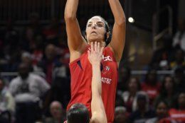 Washington Mystics forward Elena Delle Donne shoots over Las Vegas Aces guard Kelsey Plum (10) during the first half of Game 2 of a WNBA playoff basketball series Thursday, Sept. 19, 2019, in Washington. (AP Photo/Nick Wass)