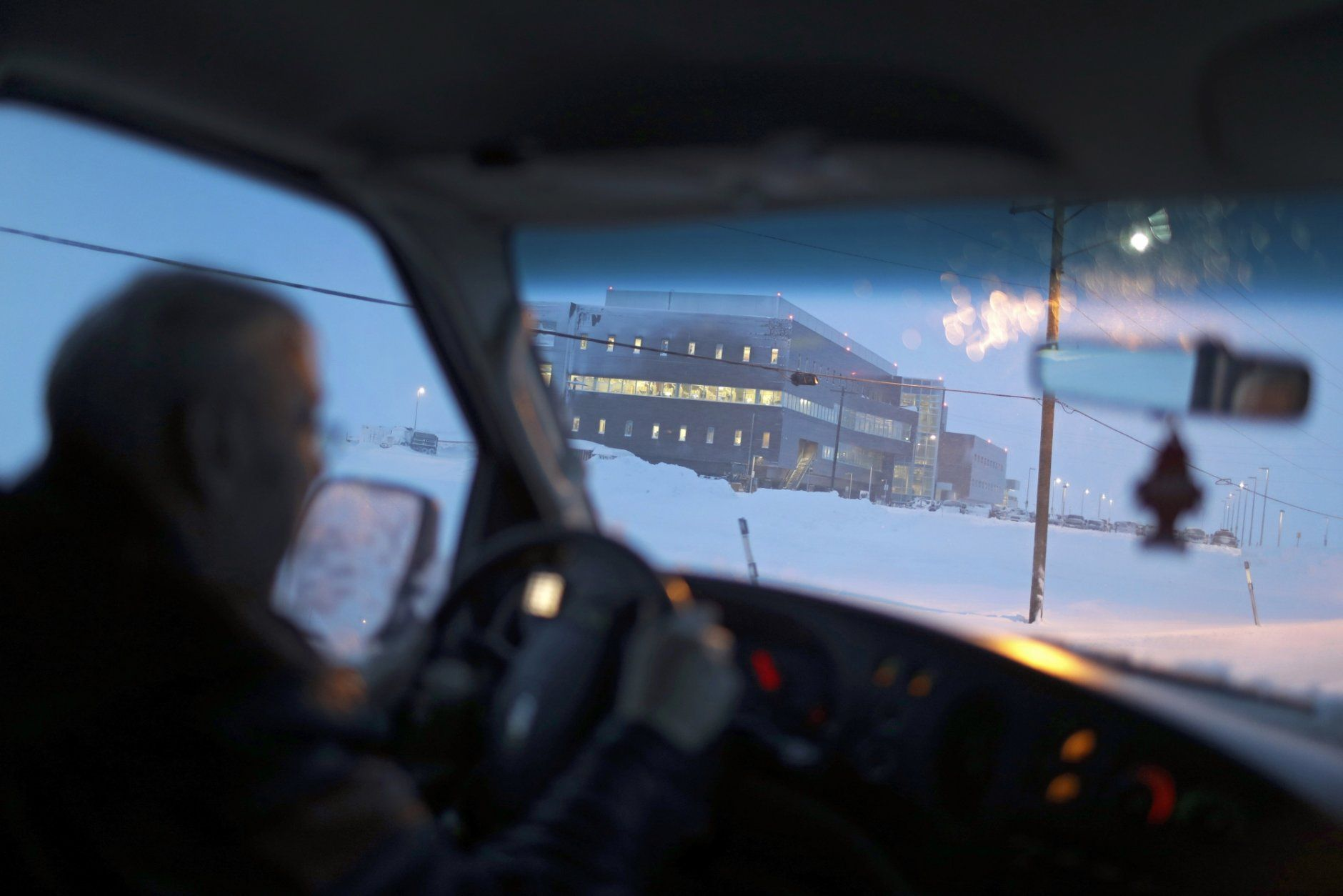 In this Feb. 21, 2019, photo, the Norton Sound Regional Hospital is seen through a taxi windshield during a storm in Nome, Alaska. The main hospital serving residents in the Bering Strait region is located about a mile from downtown Nome. (AP Photo/Wong Maye-E)