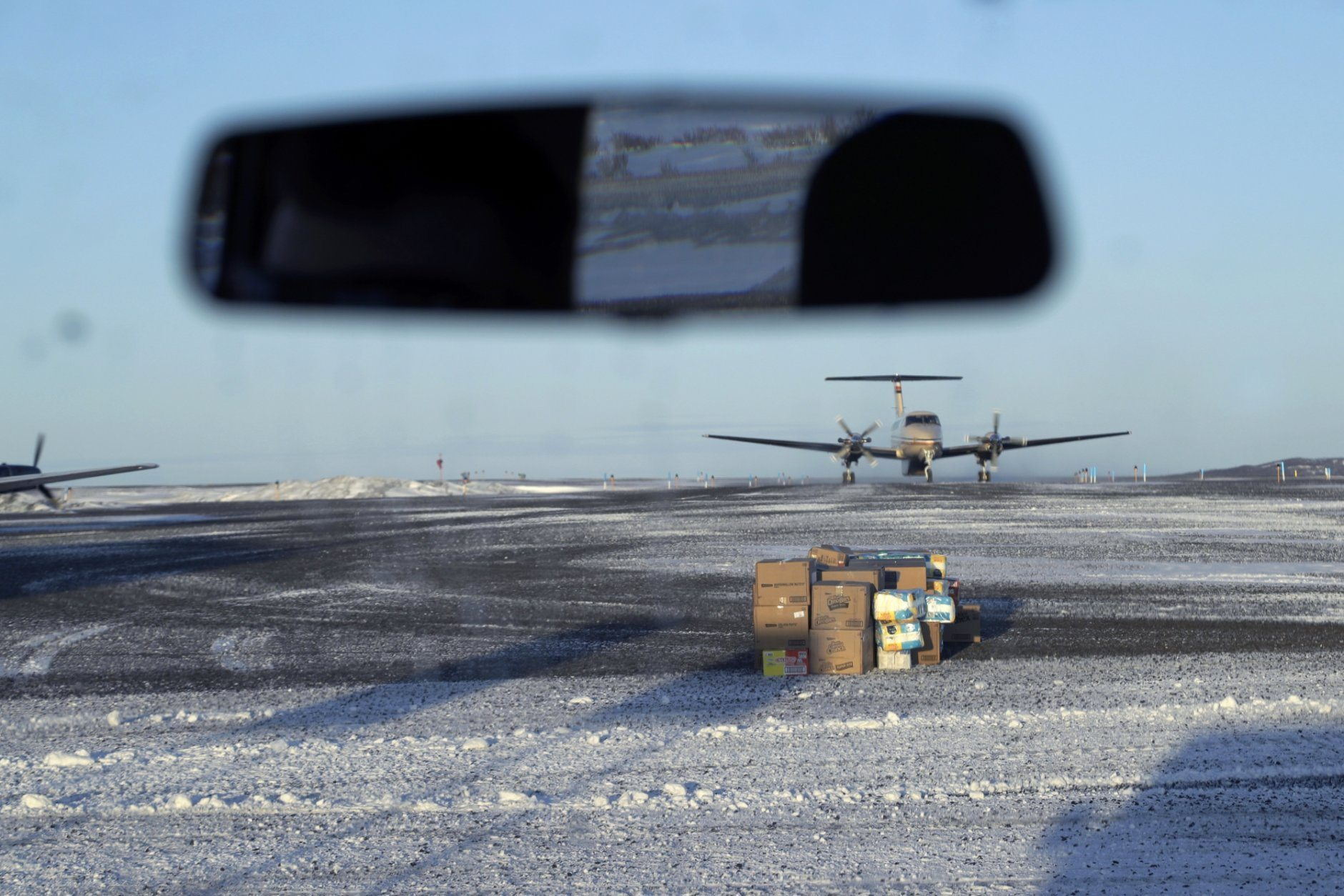 In this Feb. 19, 2019, photo, a pile of deliveries sit on the tarmac of the airport in the Native Village of St. Michael, Alaska, population 400. Transportation from villages to Nome is limited to air travel. (AP Photo/Wong Maye-E)