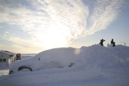 In this Feb. 14, 2019, photo, children play on a snow berm near the shores of the Bearing Sea in Nome, Alaska. Nome is approximately 100 miles from Siberia and serves as the commercial hub for Alaska's Bearing Strait region. (AP Photo/Wong Maye-E)