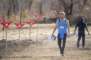 Prince Harry walks through Angola mine field, echoing Diana