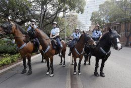 """Mounted police block a path as thousands of protestors, many of them school students, attempt to march on the streets in Sydney, Friday, Sept. 20, 2019, calling for action to guard against climate change. Australia's acting prime minister Michael McCormack has described ongoing climate rallies as """"just a disruption"""" that should have been held on a weekend to avoid inconveniencing communities. (AP Photo/Rick Rycroft)"""