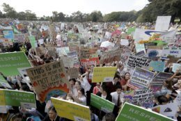"""Thousands of protestors, many of them school students, gather in Sydney, Friday, Sept. 20, 2019, calling for action to guard against climate change. Australia's acting Prime Minister Michael McCormack has described ongoing climate rallies as """"just a disruption"""" that should have been held on a weekend to avoid inconveniencing communities. (AP Photo/Rick Rycroft)"""