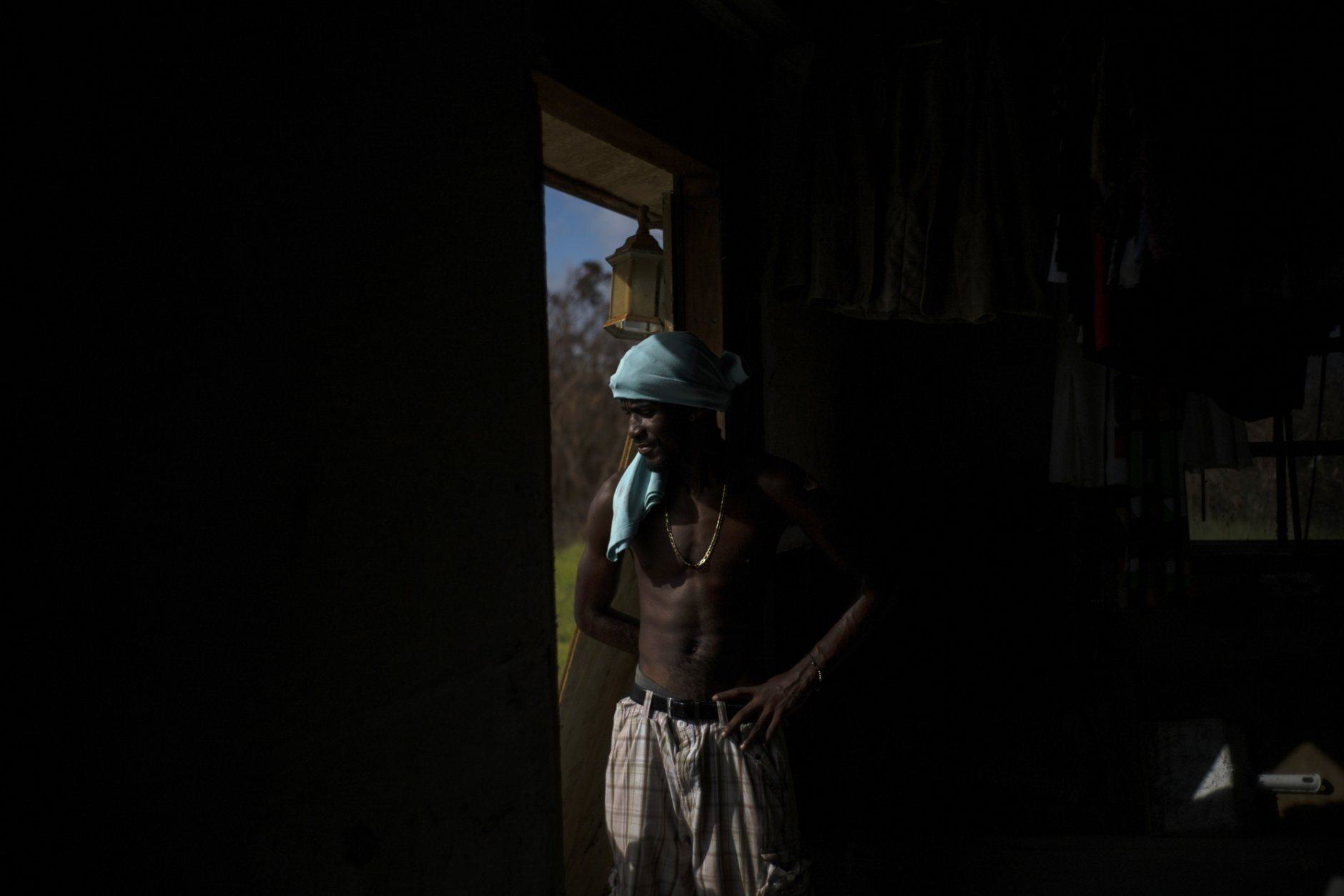 """Trevon Laing stands on the frame of his house destroyed by Hurricane Dorian, in Gold Rock Creek, Grand Bahama, Bahamas, Thursday Sept. 12, 2019. Trevor says """"After the hurricane they had me for dead, My momma was crying."""" When he returned, he said he found his brother crying on the front porch.""""I'm like, 'Hey, I'm not dead! You guys have no faith in me. I'm a survivor,'"""" he said, adding with a laugh, """"He was shocked and mad at the same time."""" (AP Photo / Ramon Espinosa)"""