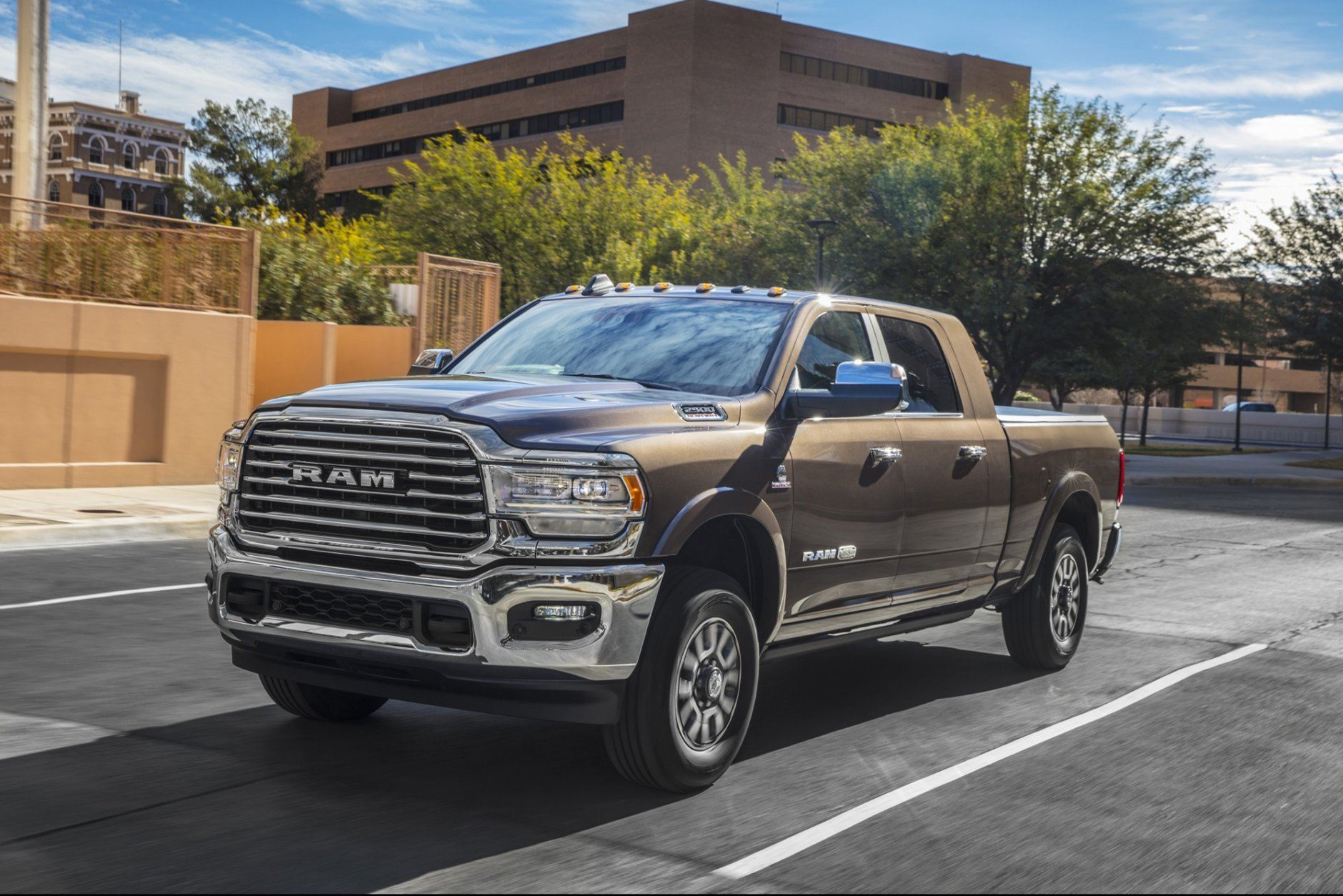 This undated photo provided by Ram shows the redesigned 2019 Ram 2500. Ram redesigned its heavy-duty lineup for 2019 with new styling, upgraded interiors, and a wide range of engine and transmission choices. As with its light-duty 1500 sibling, the Ram 2500's ace card is a unique rear coil-spring suspension that creates a more comfortable ride than its competitors. (AJ Mueller/FCA US via AP)