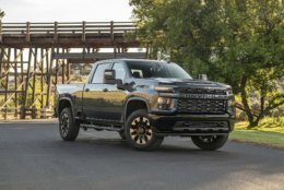 This undated photo provided by Chevrolet shows the 2020 Chevrolet Silverado 2500 HD. The Silverado 2500 HD gets a full makeover for 2020 and gains a more powerful gasoline V8 engine and a new 10-speed automatic transmission to go along with the diesel engine that makes 445 horsepower and 910 pound-feet of torque. (Jessica Lynn Walker/General Motors via AP)