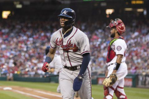 Acuña, Braves pound Nationals, clinch playoff spot