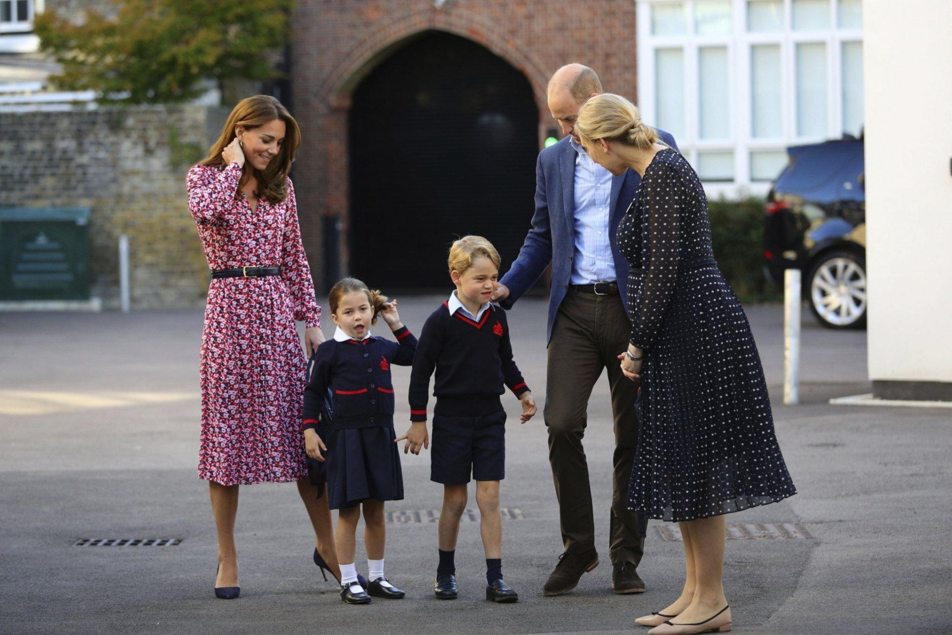Helen Haslem, right, head of the lower school greets Britain's Princess Charlotte, second left, for her first day of school at Thomas's Battersea in London, with her brother Prince George and their parents Prince William and Kate, Duchess of Cambridge, Thursday Sept. 5, 2019. (Aaron Chown/Pool via AP)