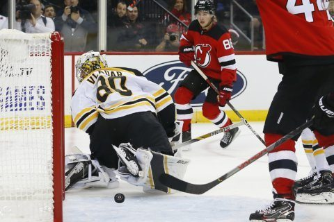 Hughes scores 2 in preseason debut for Devils