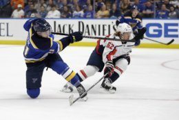 St. Louis Blues' Tyler Bozak, left, scores past Washington Capitals' Carl Hagelin, of Sweden, during the second period of an NHL preseason hockey game Friday, Sept. 27, 2019, in St. Louis. (AP Photo/Jeff Roberson)