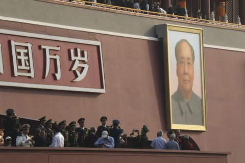 China's 70-year parade shows global ambition as HK protests