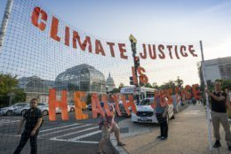 Climate activists participate in a 'Shut Down DC' protest to urge action on the climate crisis, on Independence Avenue near Capitol Hill in Washington, Monday, Sept. 23, 2019. (AP Photo/J. Scott Applewhite)